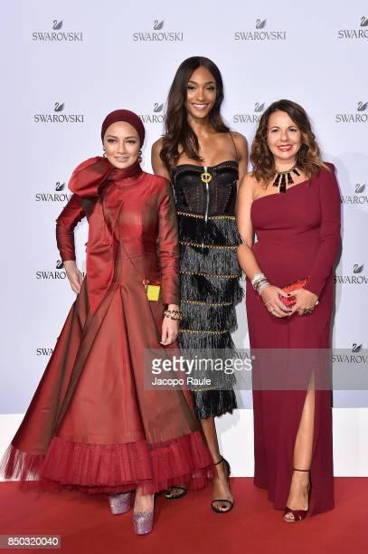 Noor Neelofa Mohd Noor Jourdan Dunn and Nathalie Colie attend Swarovski Crystal Wonderland Party on September 20 2017 in Milan Italy