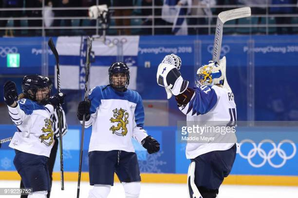 Noora Raty of Finland celebrates with her teammates after defeating Team Sweden during the Ice Hockey Women's Playoffs Quarterfinals on day eight of...