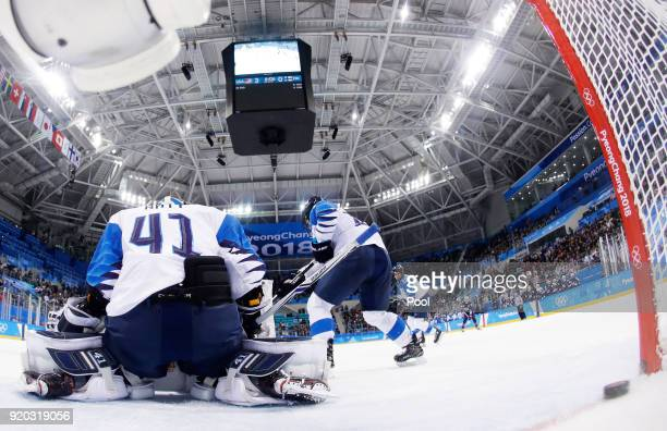 Noora Raty of Finland fails to stop a goal by Hilary Knight of the United States in the second period during the Ice Hockey Women Playoffs Semifinals...