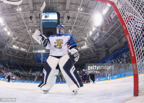 Noora Raty of Finland looks on as Gigi Marvin of the United States celebrates her goal during the Ice Hockey Women Play-offs Semifinals on day 10 of...