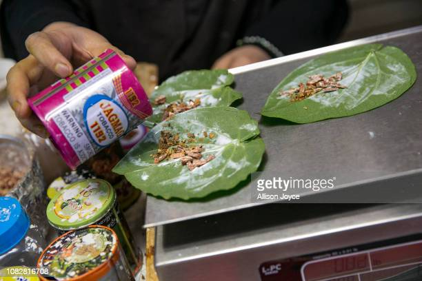 Nooraisha prepares paan leaf for customers at the Shwe Myanmar Grocery Store on January 11 2019 in Chicago Illinois Nooraisha and her family escaped...