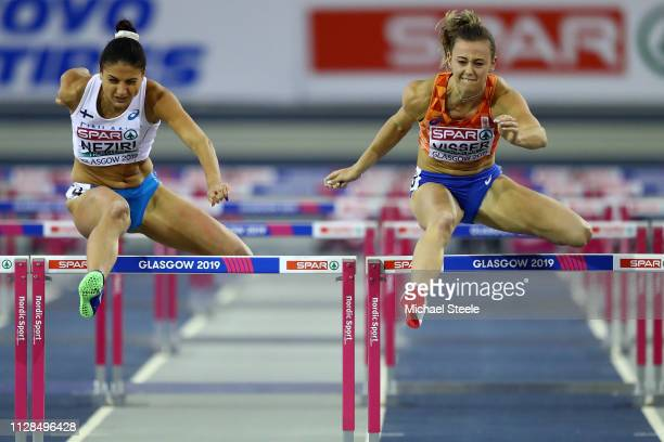 Nooralotta Neziri of Finland and Nadine Visser of The Netherlands in action during heat 1 of the women's 60m hurdles semi final on day three of the...