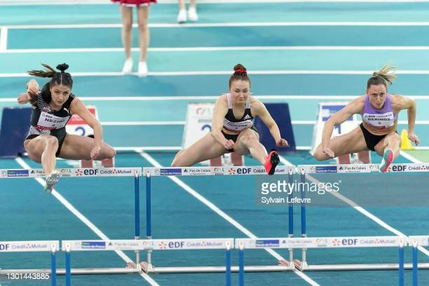 Nooralotta Neziri, Reeta Hurske, Eline Berings compete during women's 60m hurdles during the World Athletics Indoor Tour at Arena Stade Couvert on...