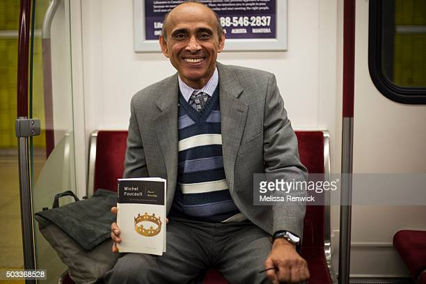 TORONTO ON NOVEMBER 19 Noorbakhsh Hooti reads Power/Knowledge by Michel Foucault on the TTC
