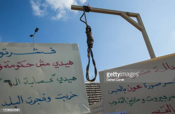 Noose and signs are displayed by protesters during an anti-government protest near the port on August 11, 2020 in Beirut, Lebanon. Last week's...