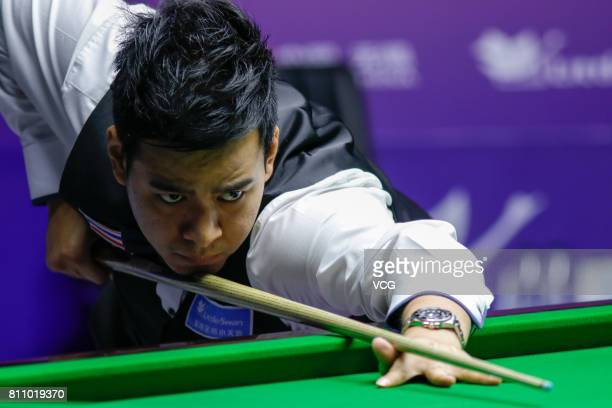 Noppon Saengkham of Thailand plays a shot during the semifinals between China A and Thailand on day 7 of 2017 Snooker World Cup at Wuxi City Sports...