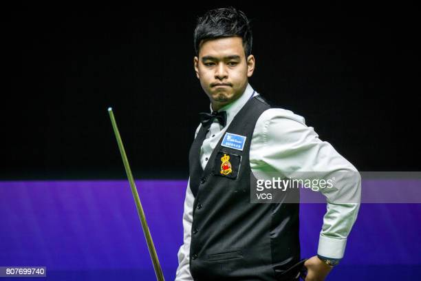 Noppon Saengkham of Thailand reacts against John Higgins of Scotland and Anthony McGill of Scotland on day one of 2017 Snooker World Cup at Wuxi City...