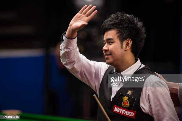 Noppon Saengkham of Thailand reacts during his first round match against Neil Robertson of Australia on day six of Betfred World Championship 2017 at...