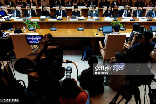 Nor Shamsiah Mohd Yunus governor of Bank Negara Malaysia center speaks during a news conference in Kuala Lumpur Malaysia on Friday Aug 17 2018 Nor...