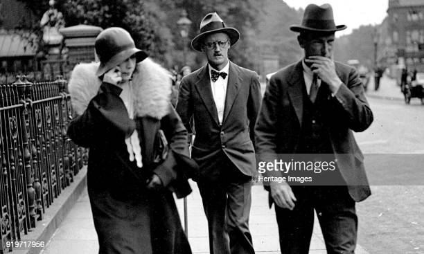 Nora Barnacle James Joyce and their solicitor n London on the day of their marriage July 4th 1931 Found in the Collection of State University of New...