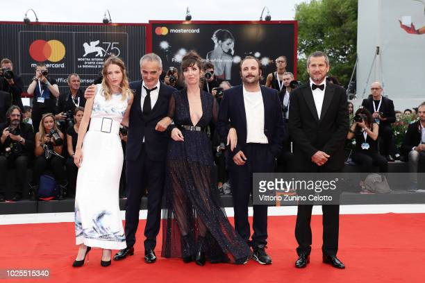 Nora Hamzawi Olivier Assayas Christa Theret Vincent Macaigne and Guillaume Canet walk the red carpet ahead of the 'Doubles Vies ' screening during...