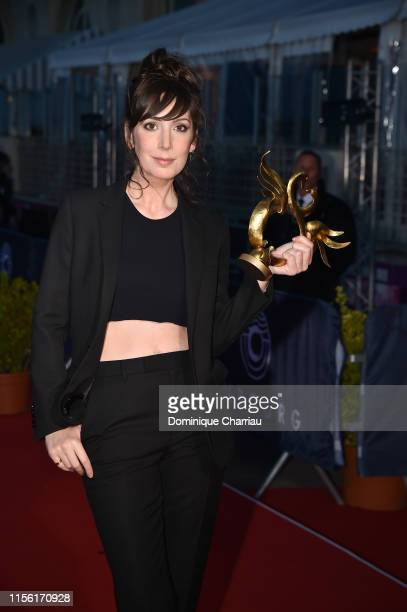 Nora Hamzawi poses with her award for Female Revelation during the 33rd Cabourg Film Festival Day Four on June 15 2019 in Cabourg France