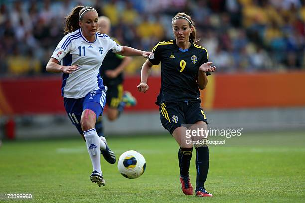 Nora Heroum of Finland challenges Kosovare Asllani of Sweden during the UEFA Women's EURO 2013 Group A match between Finland and Sweden at Gamla...