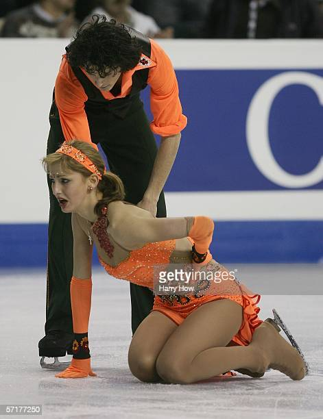 Nora Hoffmann is assisted by Attila Elek of Hungary who competed despite an injury on her left elbow from a fall during warmups in the Ice Dancing...