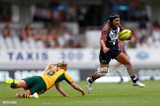 Nora Maaka of New Zealand breaks through a tackle during the match between New Zealand and Australia in the 2015 Auckland Nines at Eden Park on...