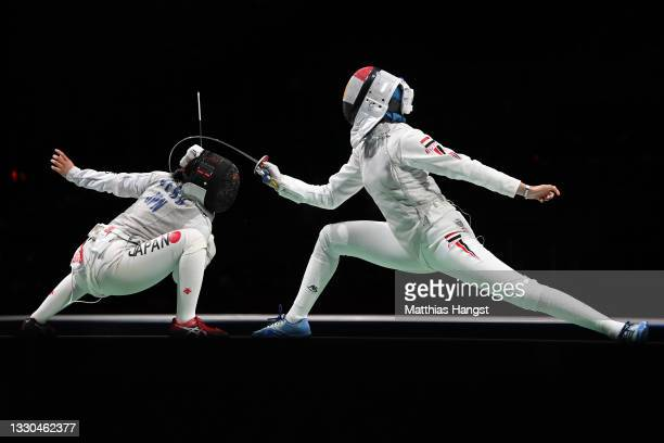 Nora Mohamed of Team Egypt, right, competes against Yuka Ueno of Team Japan in Women's Individual Foil first round on day two of the Tokyo 2020...