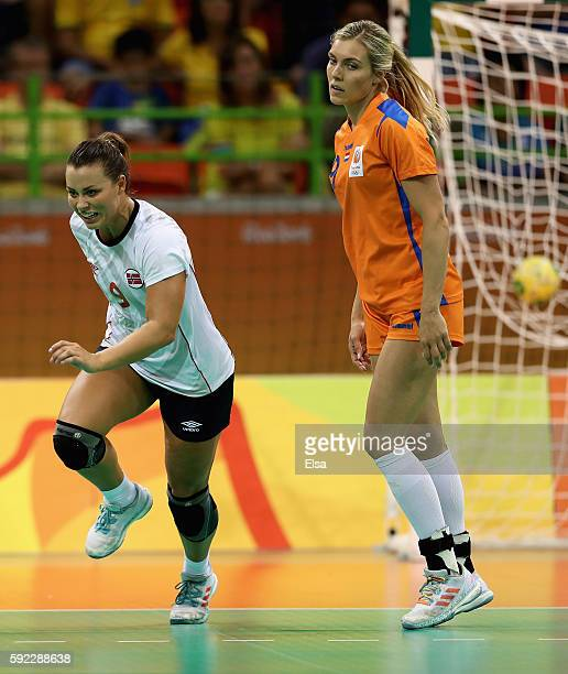Nora Mork of Norway and Sanne van Olphen of Netherlands react during the Women's Handball Bronze medal match between Netherlands and Norway at Future...