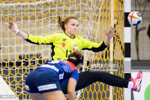 Nora Mork of Norway and Weronika Gawlik of Poland in action during IHF Women's Handball World Championship match between Norway and Poland on...