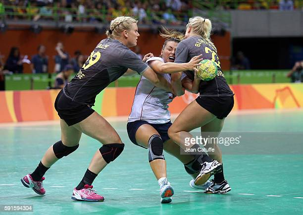 Nora Mork of Norway Jenny Alm and Hanna Blomstrand of Sweden in action during the handball match between Norway and Sweden in the Women's...
