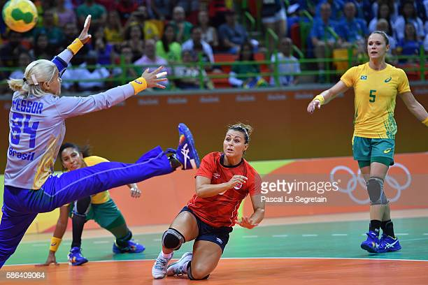 Nora Mork of Norway shoots during the women's preliminaries Group A handball match Norway vs Brazil as goal keeper Mayssa Raquel Pessoa of Brazil...
