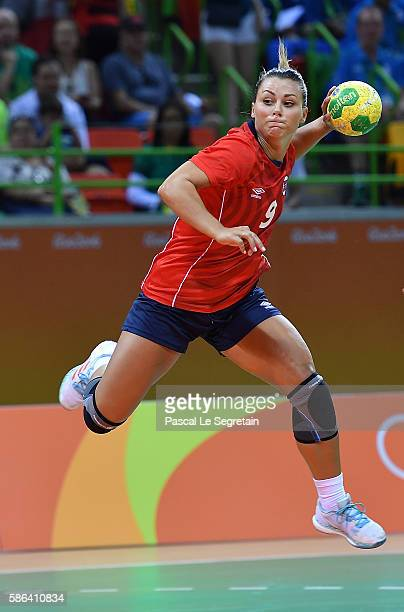 Nora Mork of Norway shoots during the women's preliminaries Group A handball match Norway vs Brazil on Day 1 of the Rio 2016 Olympic Games at Future...