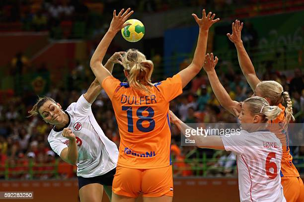 Nora Mork of Norway takes a shot during the Women's Handball Bronze medal match between Netherlands and Norway at Future Arena on Day 15 of the Rio...