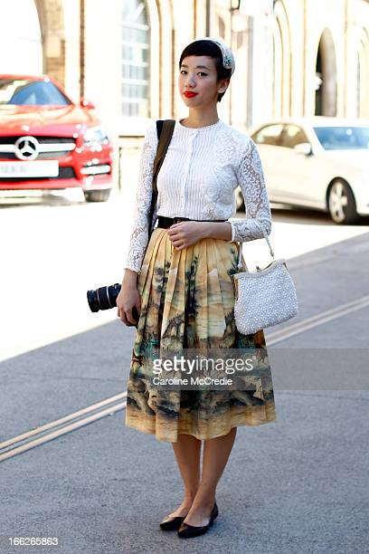 Nora Tong wears a vintage outfit at MercedesBenz Fashion Week Australia Spring/Summer 2013/14 at Carriageworks on April 11 2013 in Sydney Australia