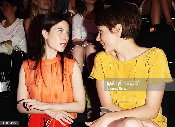 Nora von Waldstaetten and Julia Koschitz sit in front row at the Strenesse Blue Show during MercedesBenz Fashion Week Berlin Spring/Summer 2012 at...
