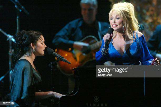 Norah Jones and Dolly Parton perform onstage at the '37th Annual CMA Awards' at the Grand Ole Opry House November 5 2003 in Nashville Tennessee