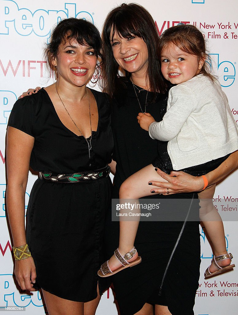 Norah Jones and Mandy Lyons (with daughter Hattie Lyons Lyons) attend 2013 NYWIFT Designing Women Awards at The McGraw-Hill Building on May 23, 2013 in New York City.