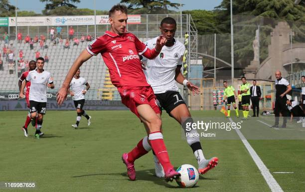 Norbert Gyomber of AC Perugia and Delano Burgzorg of AS Spezia compete for the ball during the Serie B match between AS Spezia and AC Perugia at...