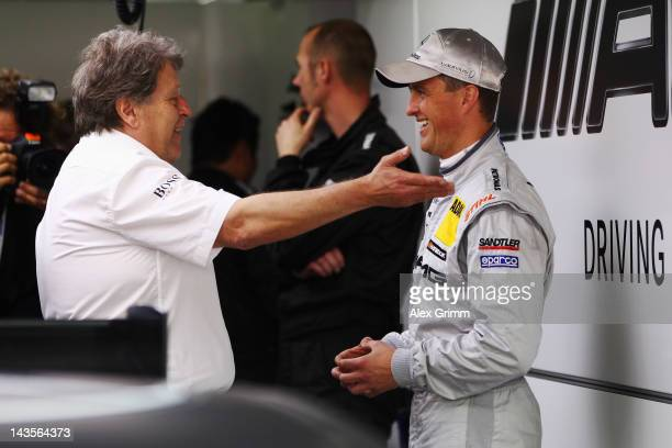 Norbert Haug, director of Mercedes Motorsport, chats with Mercedes AMG driver Ralf Schumacher prior to the first race of the DTM German Touring Car...