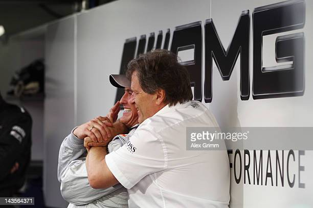 Norbert Haug, director of Mercedes Motorsport, hugs Mercedes AMG driver Ralf Schumacher prior to the first race of the DTM German Touring Car...