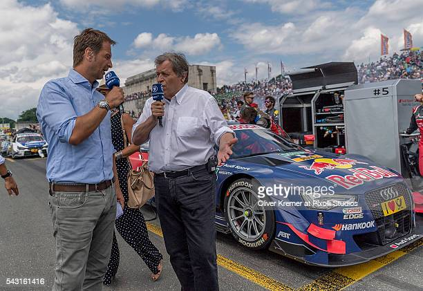 Norbert Haug of Mercedes getting interviewed prior to the German Touring Car Championship race at the Norisring during Day 3 of the 74 International...