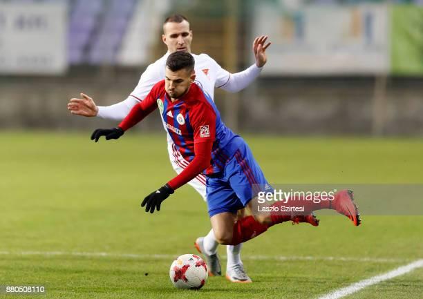 Norbert Konyves of DVSC fouls Szilveszter Hangya of Vasas FC during the Hungarian OTP Bank Liga match between Vasas FC and DVSC at Ferenc Szusza...