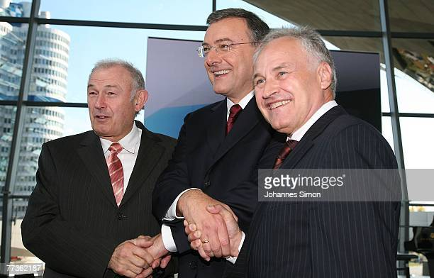Norbert Reithofer CEO of BMW car producer Bavaria's State Governor Guenther Beckstein and Erwin Huber head of the Christian Social Union pose after...