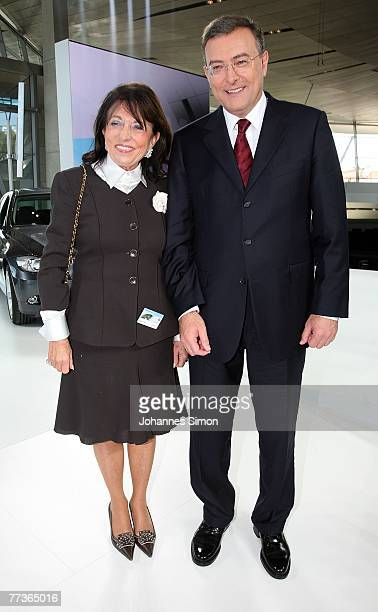 Norbert Reithofer CEO of BMW car producers and car rental owner Regine Sixt pose after the opening of the BMW World on October 17 2007 in Munich...