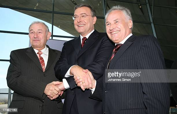 Norbert Reithofer CEO of BMW car producers Bavaria's State Governor Guenther Beckstein and Erwin Huber head of the Christian Social Union pose after...