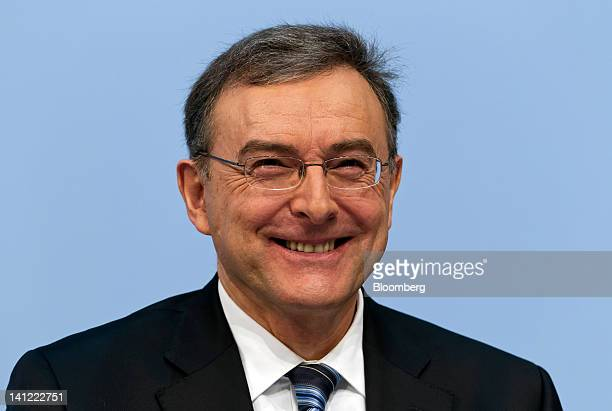 Norbert Reithofer chief executive officer of Bayerische Motoren Werke AG reacts during the company's annual news conference in Munich Germany on...