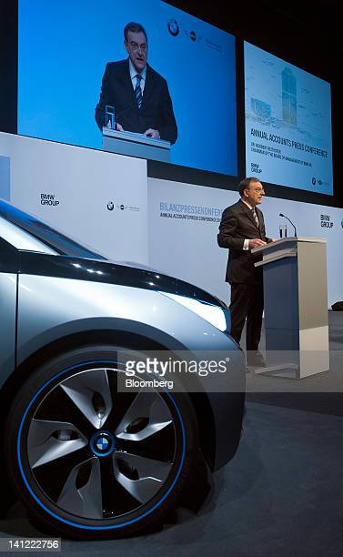 Norbert Reithofer chief executive officer of Bayerische Motoren Werke AG is seen projected on a screen as he speaks during the company's annual news...