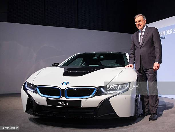 Norbert Reithofer chief executive officer of Bayerische Motoren Werke AG poses for a photograph beside a BMW i8 plugin hybrid automobile during a...