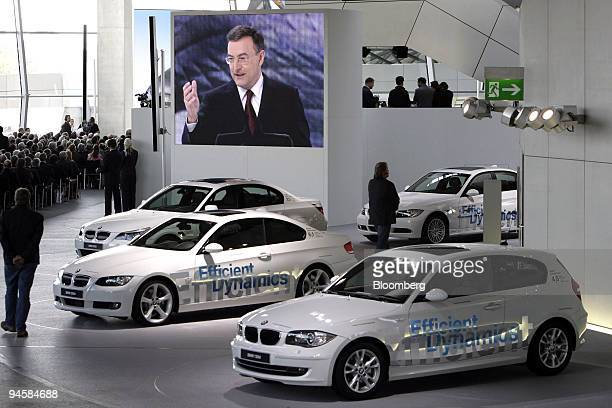 Norbert Reithofer chief executive officer of Bayerische Motoren Werke AG speaks on a monitor at the opening ceremony for the new BMW World customer...