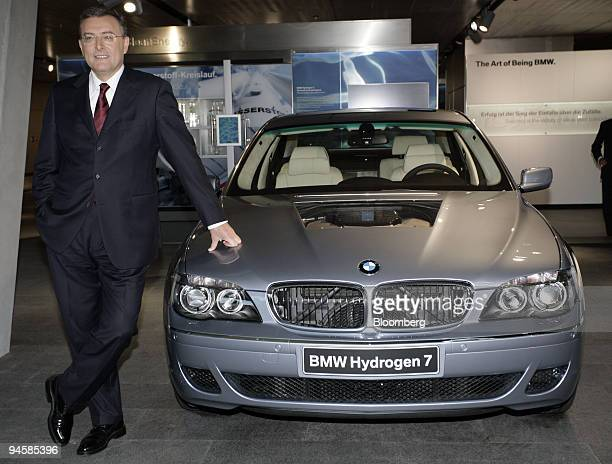 Norbert Reithofer chief executive officer of Bayerische Motoren Werke AG poses next to a BMW hydrogen car at the opening ceremony for the new BMW...