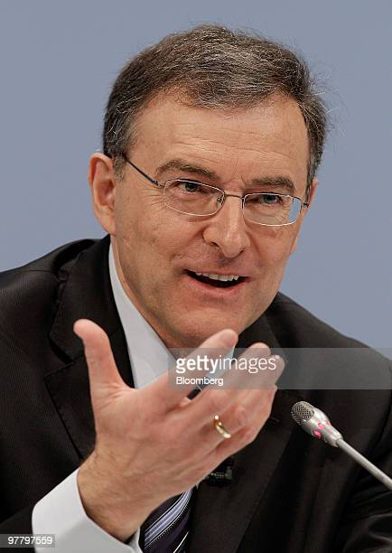 Norbert Reithofer chief executive officer of Bayerischen Motoren Werke AG gestures while speaking during the company's news conference in Munich...