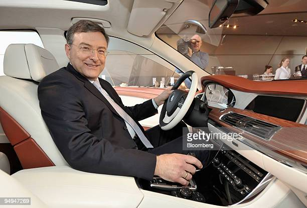 Norbert Reithofer chief executive officer of BMW Group poses inside a BMW Concept 5 series Gran Turismo automobile in Munich Germany on Wednesday...