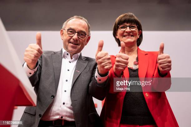 Norbert WalterBorjans and Saskia Esken celebrate after being elected as new coleaders of the German Social Democrats at the SPD federal party...