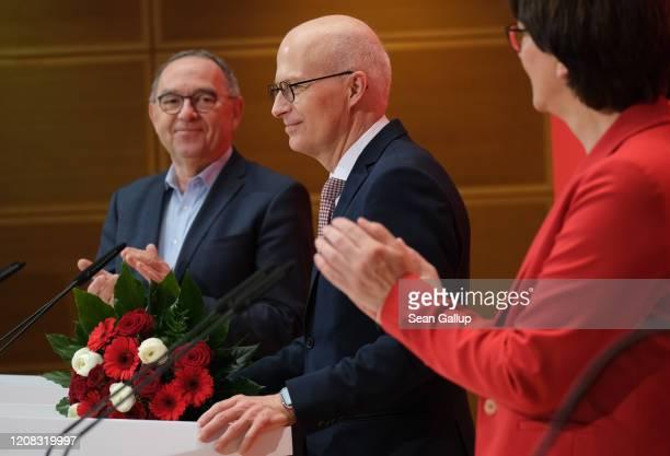 Norbert WalterBorjans and Saskia Esken leadership duo of the German Social Democrats congratulate SPD Hamburg candidate Peter Tschentscher the day...