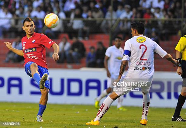 Norberto Araujo of Ecuador's Liga de Quito vies for the ball with Derlis Orue of Paraguay's Nacional during their Copa Sudamericana football match at...