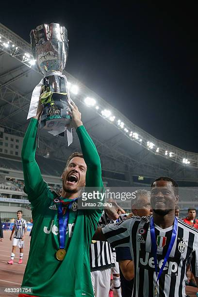 Norberto Neto of Juventus celebrates with the trophy after winning the Italian Super Cup final football match between Juventus and Lazio at Shanghai...
