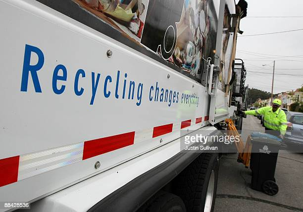 Norcal Waste worker Angelo Borg prepares to dump bins with trash and recyclable materials into a truck while collecting recyclable materials in a...